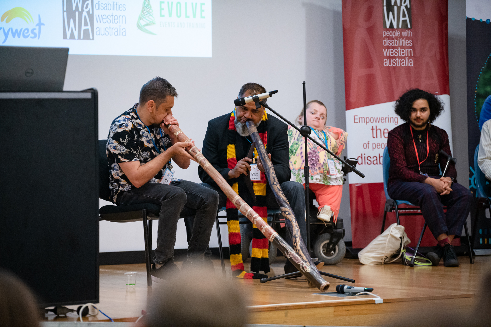Photo of Shaun Nannup and Greg Barr playing the Digeridoo.